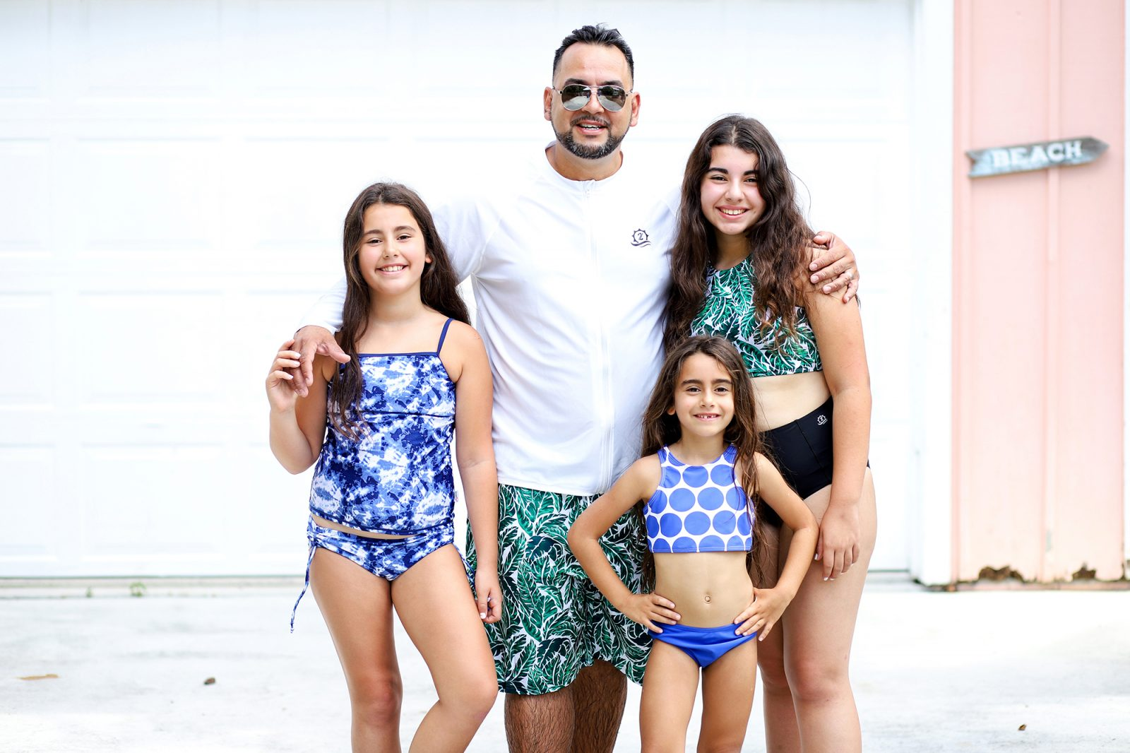 Family at an AirBnB wearing SwimZip