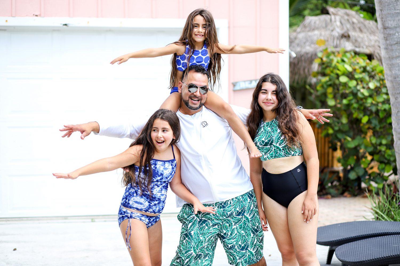 Family wearing uv protective swimwear from SwimZip