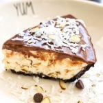 slice of almond joy ice cream pie featuring toasted coconut and almond ice cream topped with chocolate ganage