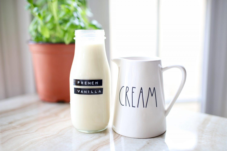 homemade french vanilla creamer next to a rae dunn cream pitcher