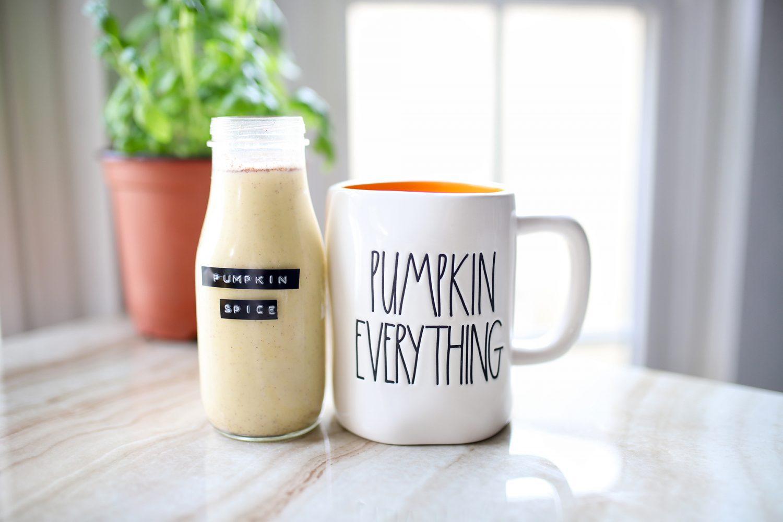 homemade pumpkin spice creamer next to a rae dunn pumpkin everything mug