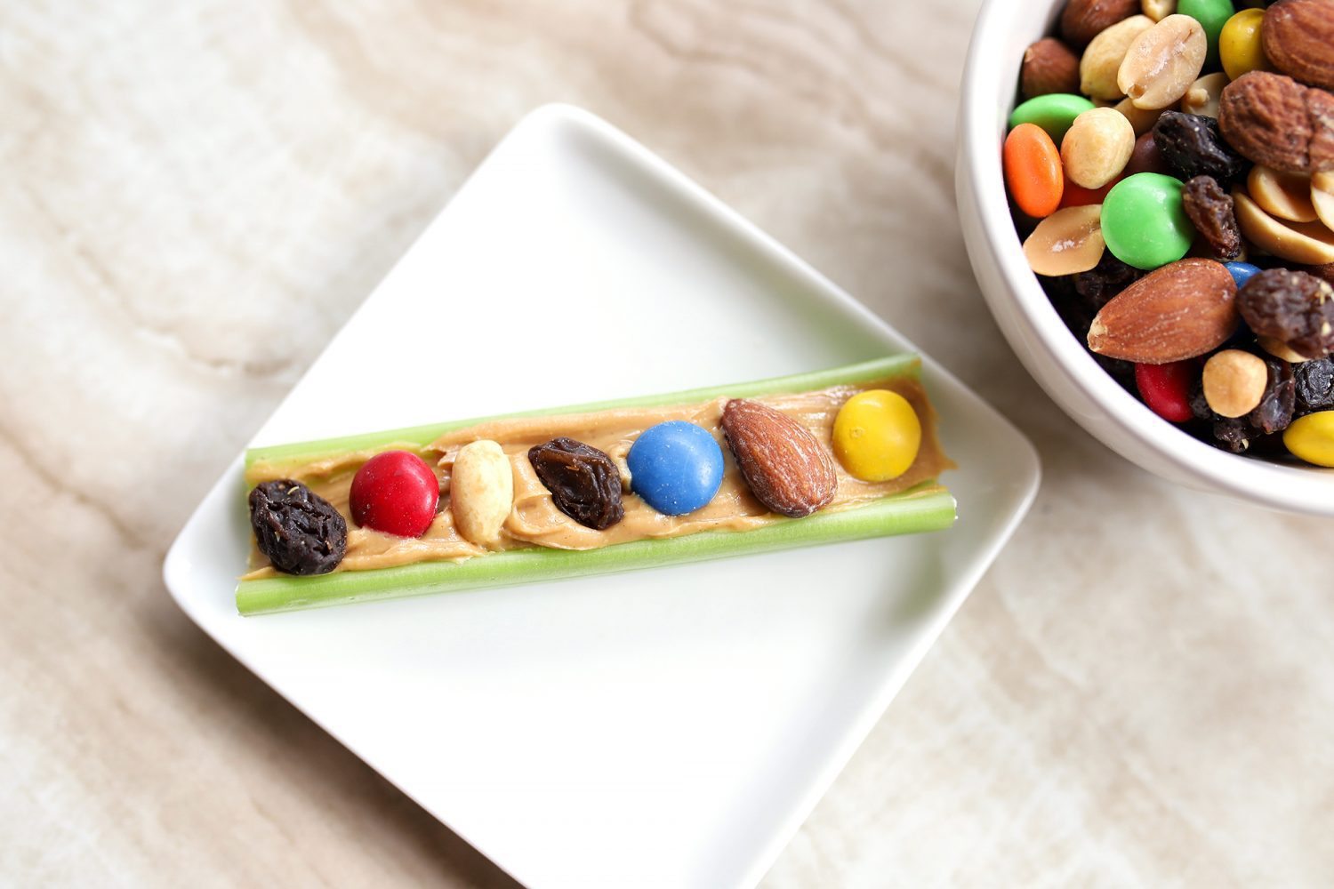 celery topped with peanut butter and trail mix