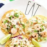 plate with shrimp tostadas and lime slices