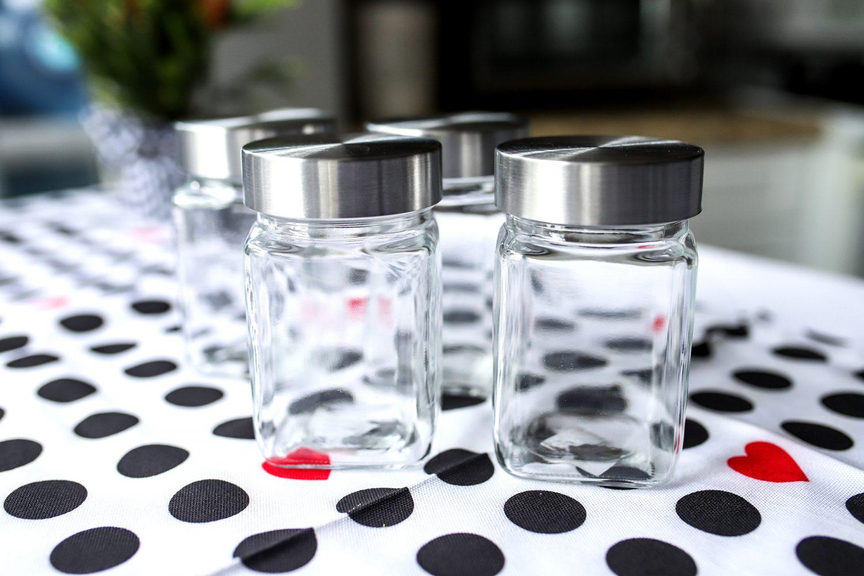 empty jars on a polka dot table cloth