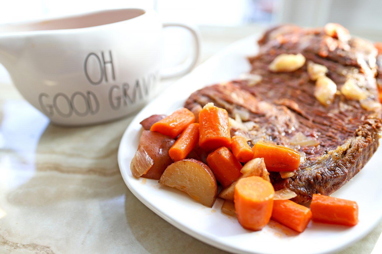 pot roast potatoes and carrots on a plate