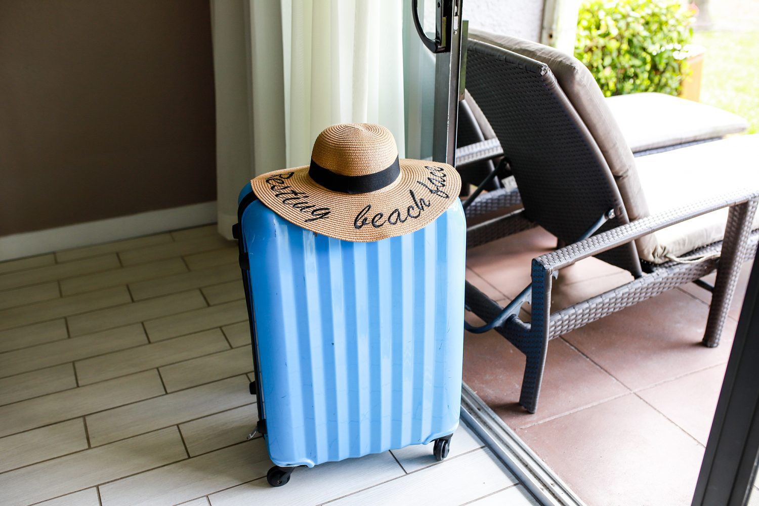 suitcase with a beach hat on top