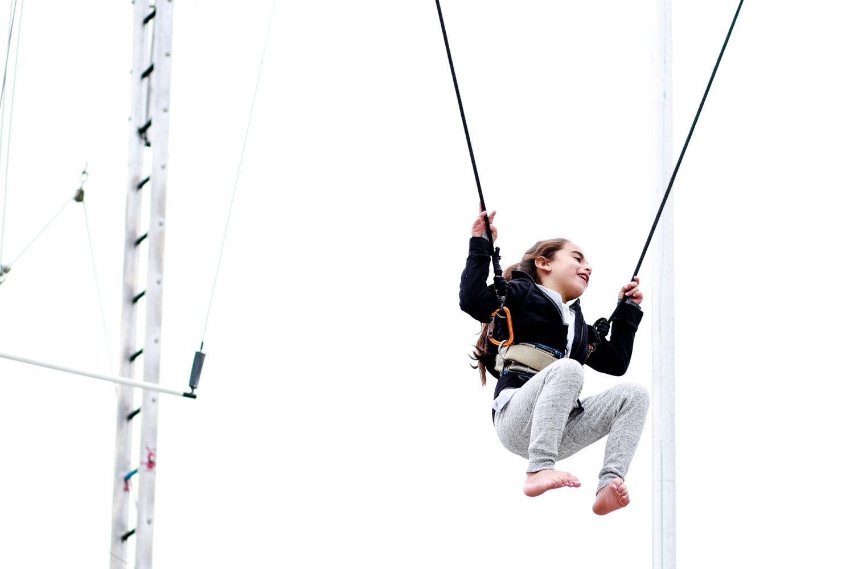 little girl having fun on trapeze