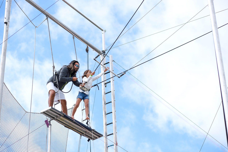 little girl grabbing her trapeze bar
