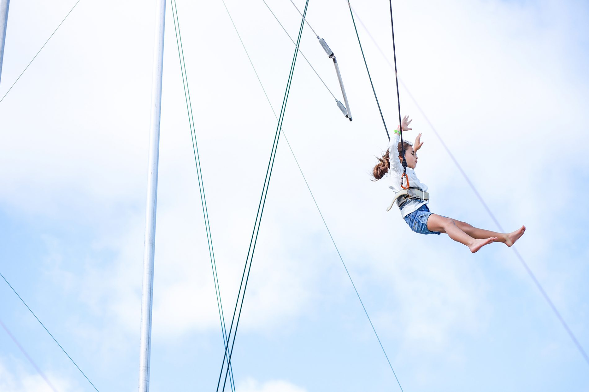 little girl letting go of trapeze