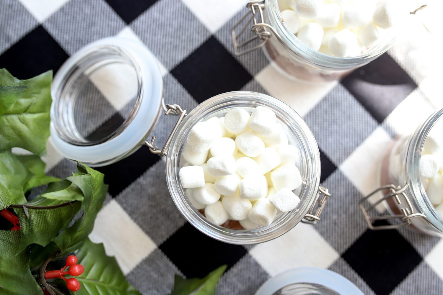 jars filled with ingredients for hot cocoa