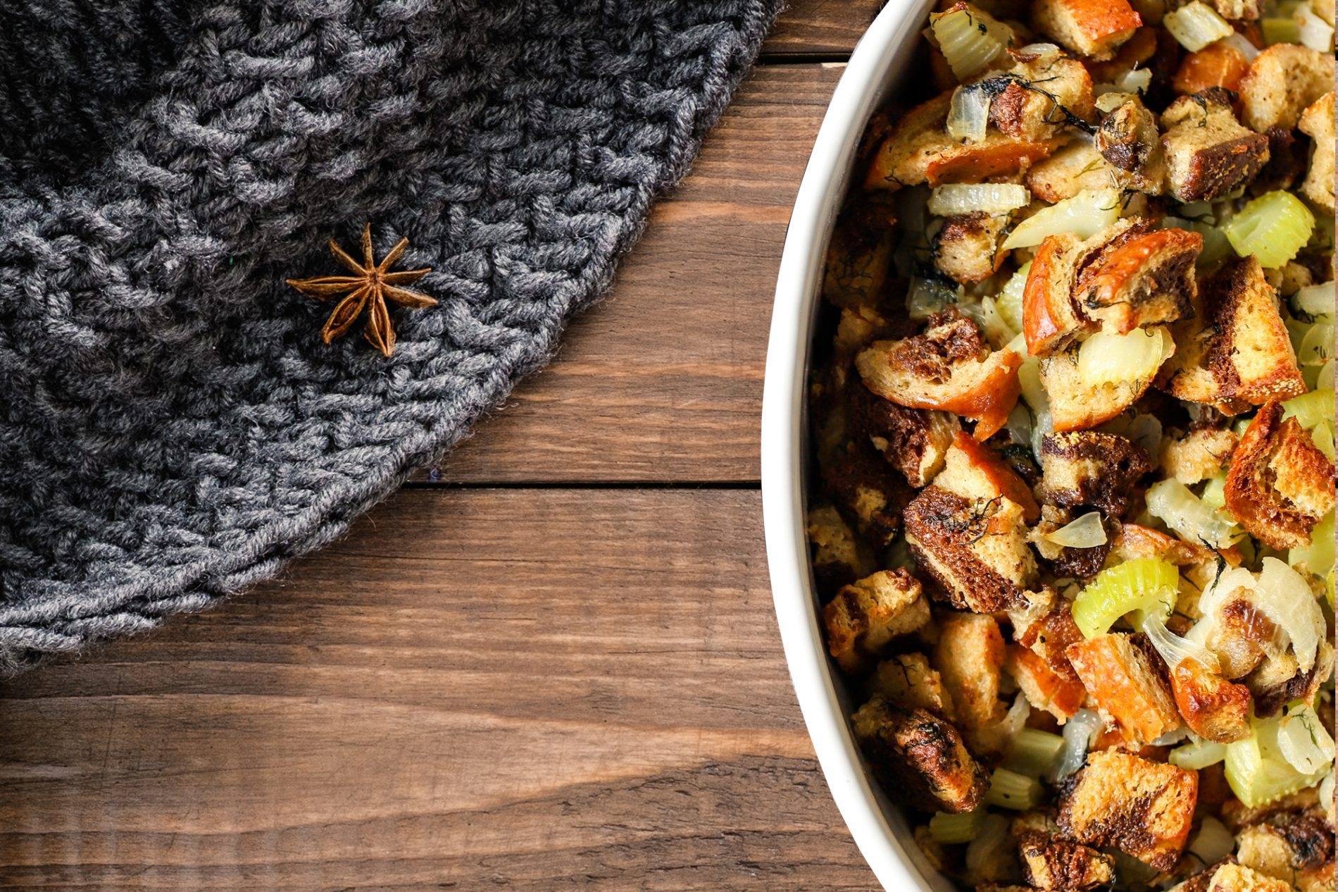 thanksgiving stuffing on a wooden table with a gray blanket