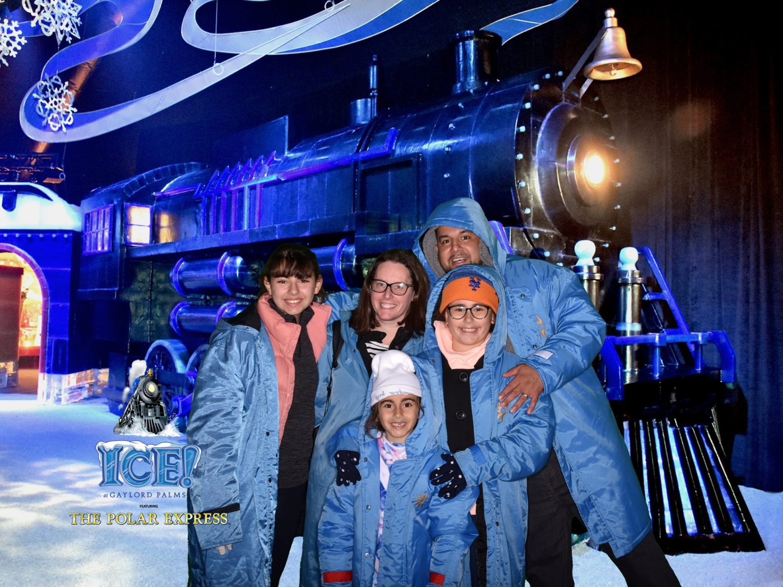Family standing in front of Polar Express at ICE!