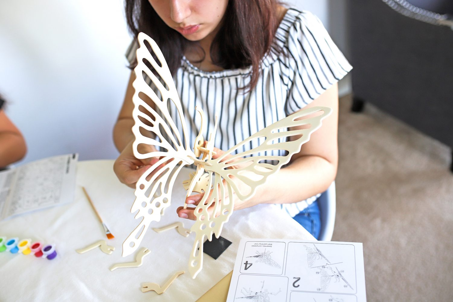 putting together a 3d butterfly puzzle