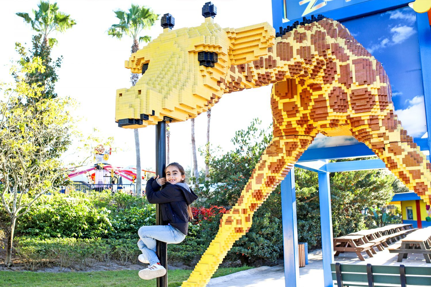 girl and a giraffe made out of legos