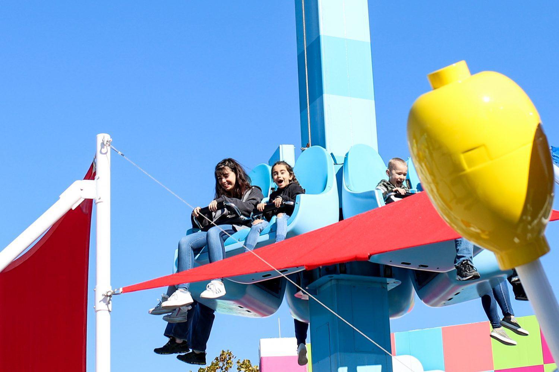 sisters enjoying a ride at legoland