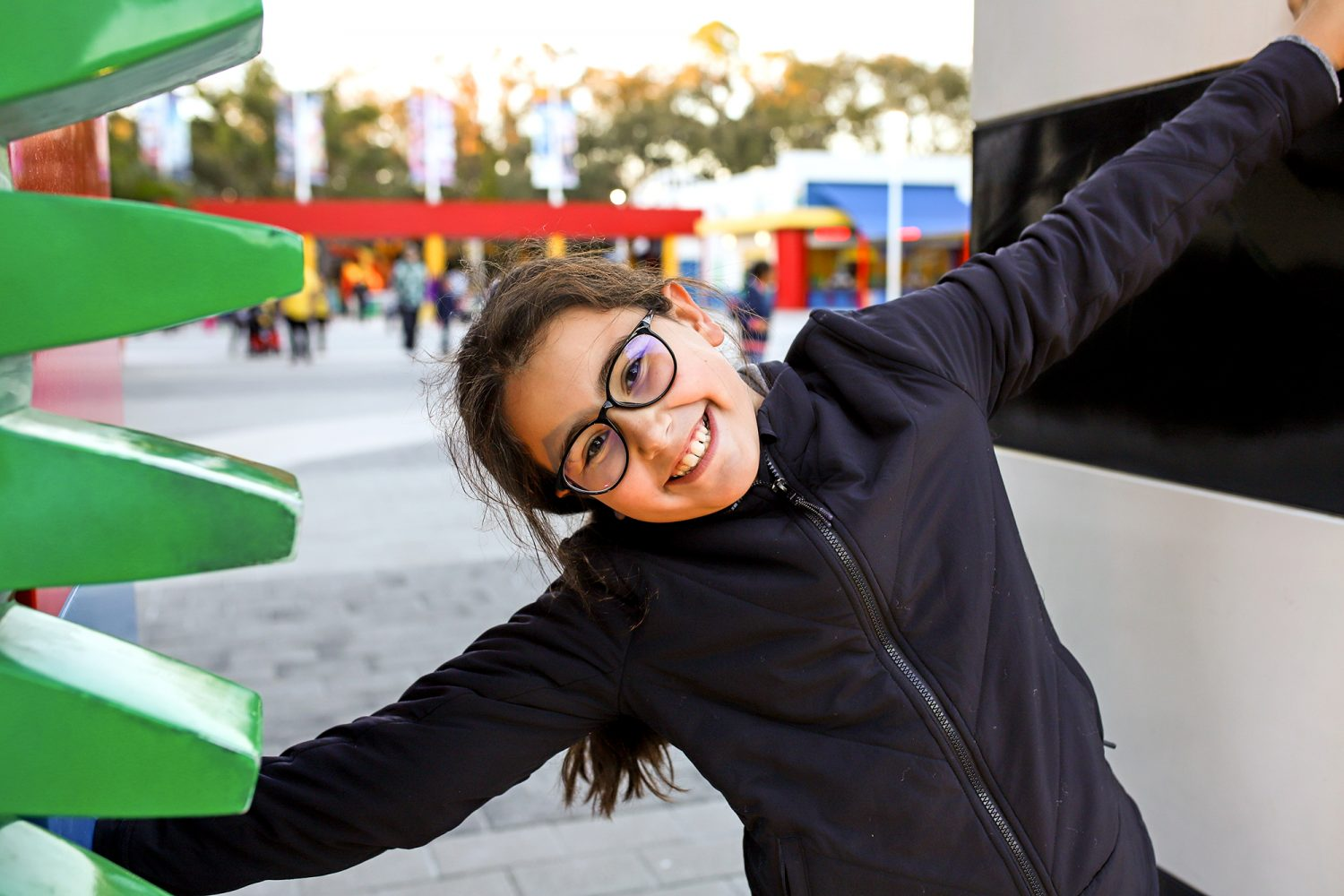 girl smiling at the entrance of legoland