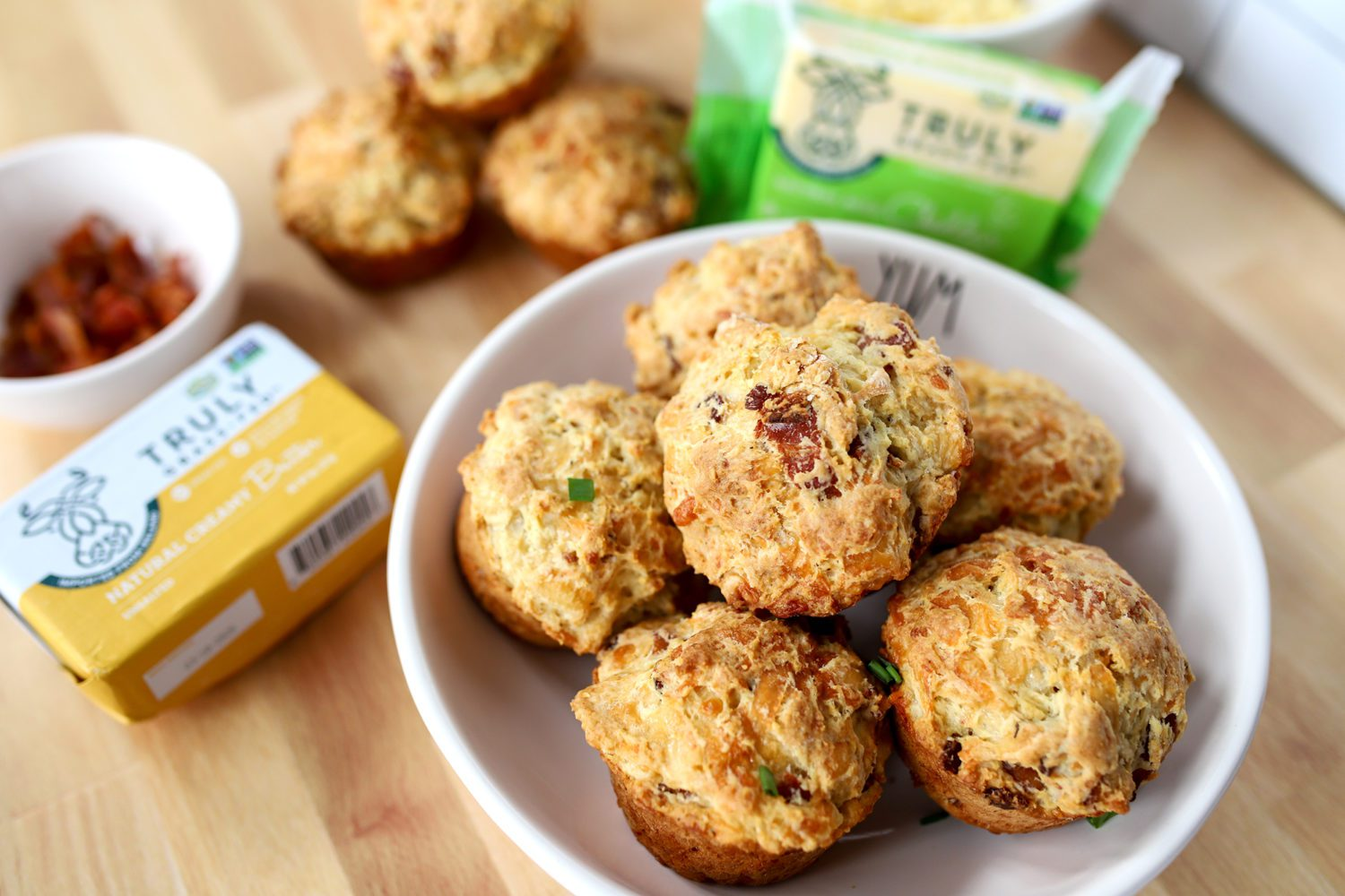 cheesy bacon irish soda bread muffins and ingredients on a counter