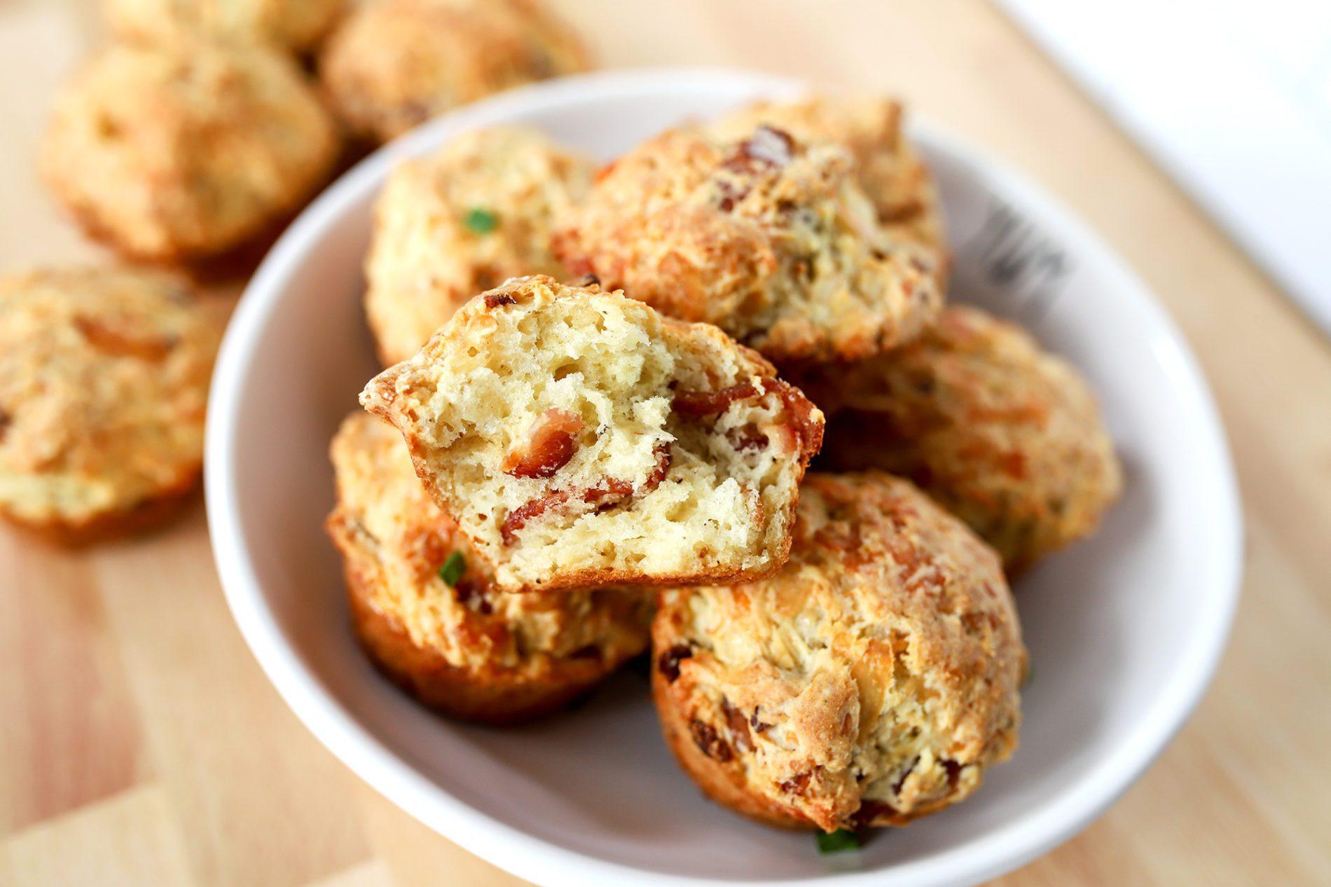 bowl of cheesy bacon irish soda bread muffins