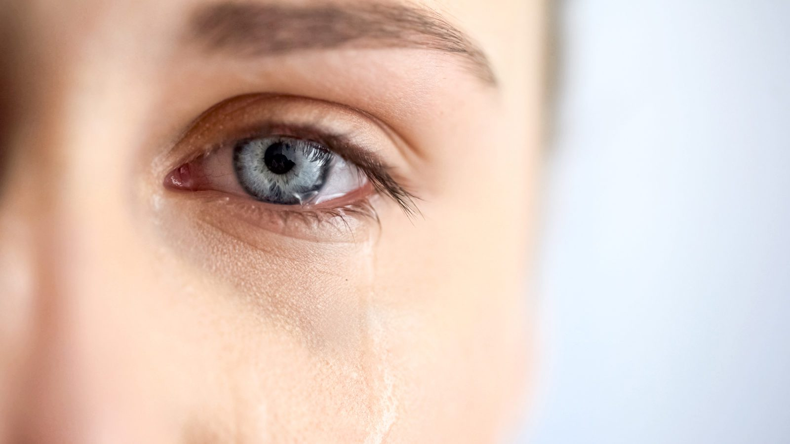 close up of woman crying