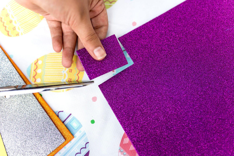 cutting a square out of glitter foam