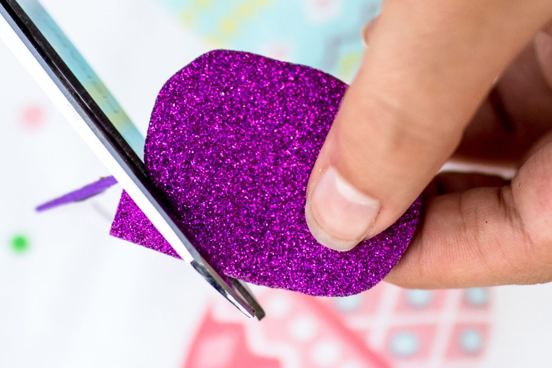 cutting an oval shape out of glitter foam