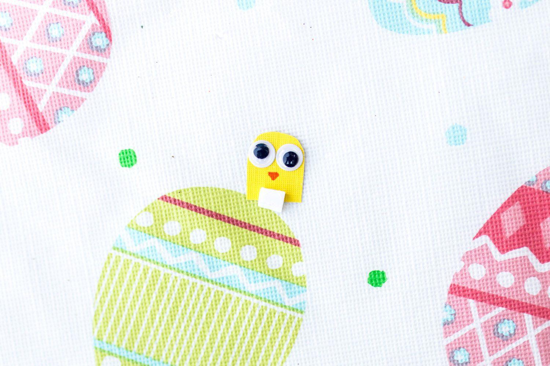 tiny chick head with google eyes