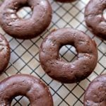 chocolate donuts on a cooling rack