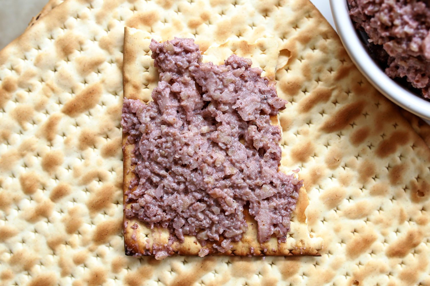piece of matzoh with charoset spread on top