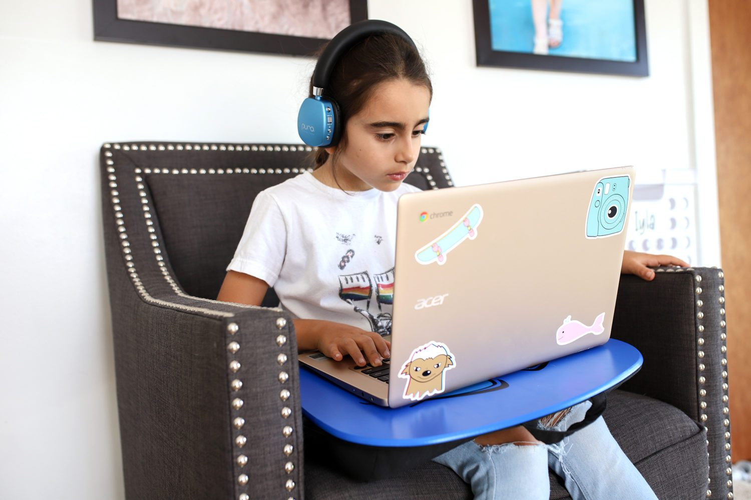 girl on her laptop with headphones on