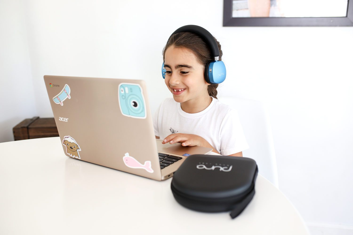 girl smiling and enjoying distance learning