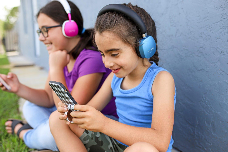 two girls with purosound headphones
