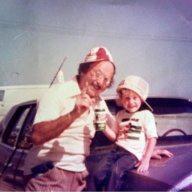 old photo of grandpa and granddaughter