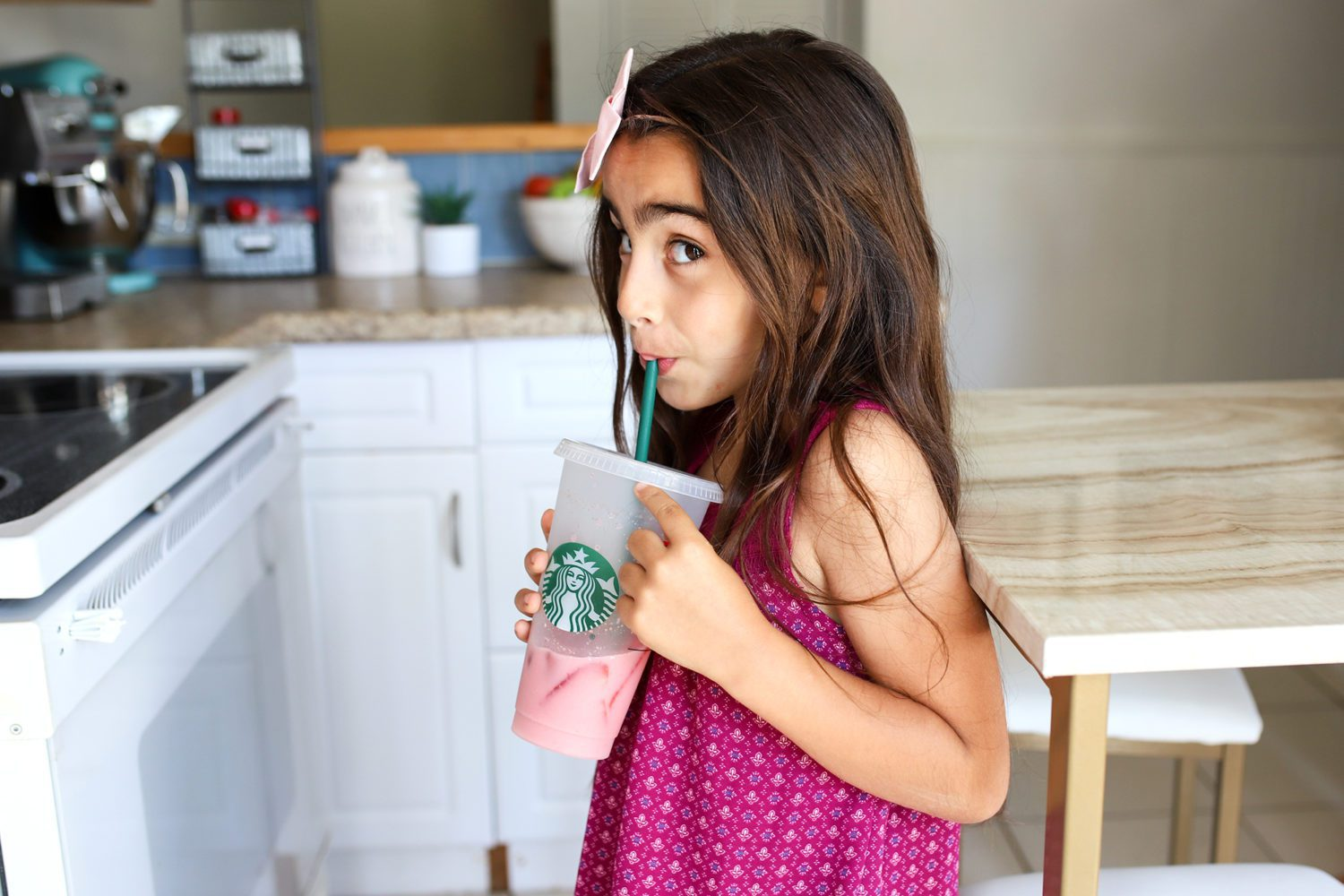 little girl enjoying a drink in her starbucks cup