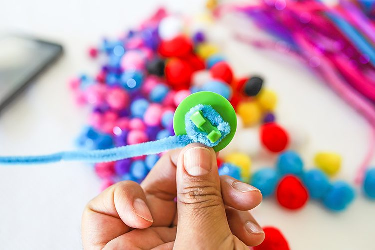how to attach a pipe cleaner to the bottom of a ring pop