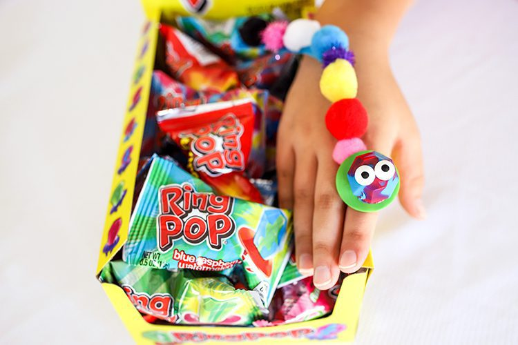 a finger puppet made out of a ring pop