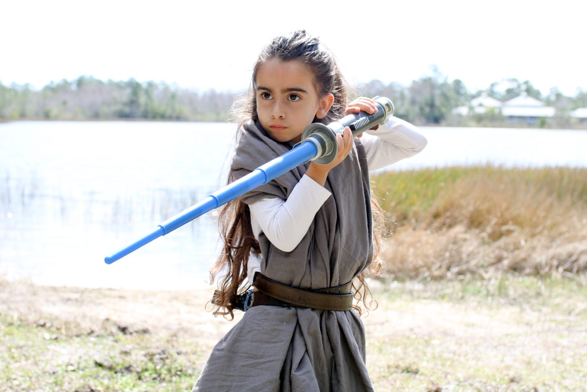 Little girl dressed as a Jedi from Star Wars