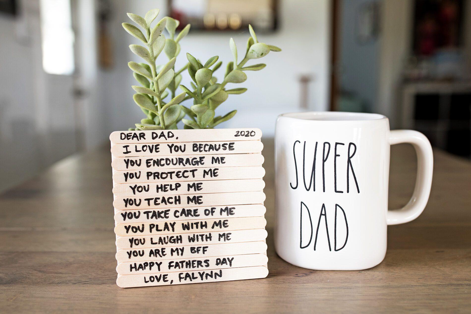 handmade father's day coaster next to super dad mug