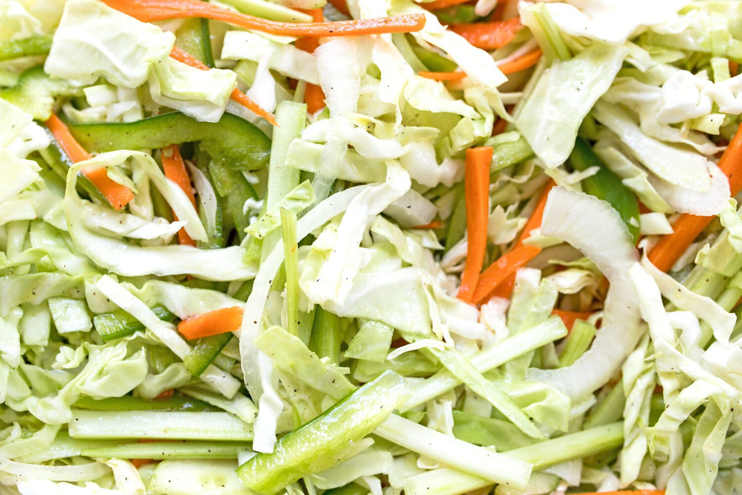 sliced cabbage, onion, carrot, celery, green pepper and cucumbers