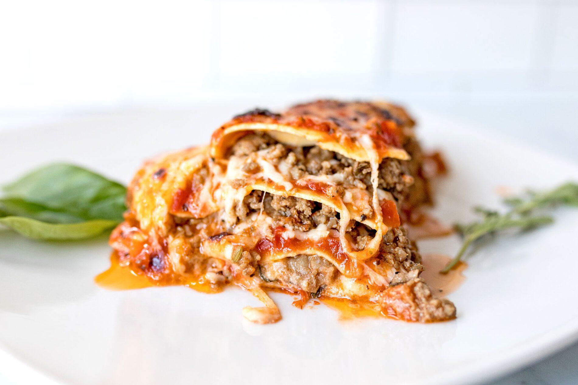 slice of super meaty and cheesy lasagna