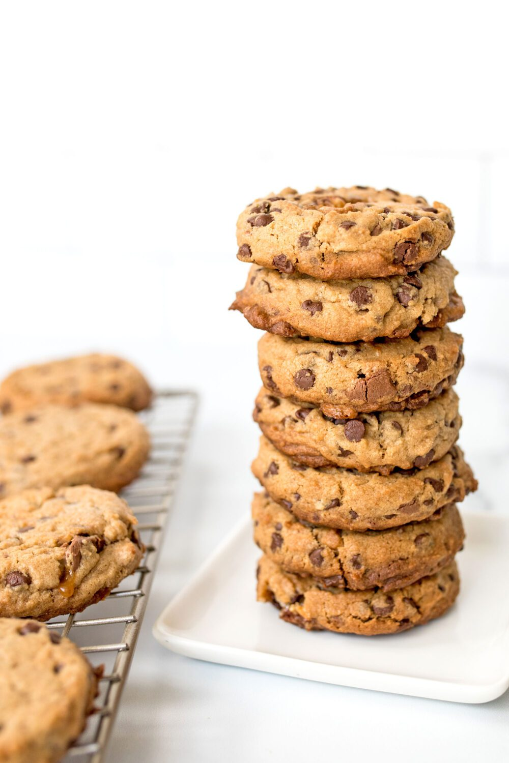 stack of cookies next to a cooling rack