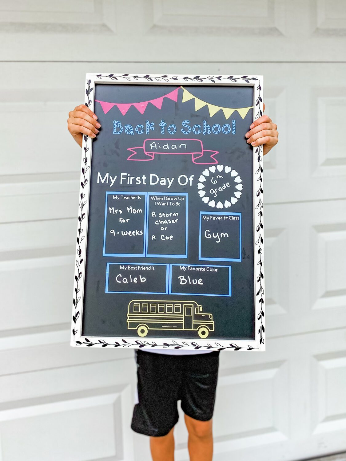 This adorable chalkboard sign photo prop idea from Mommyhood Life is perfect not only for this year, but for years to come. I love the idea of decorating a chalkboard that can be wiped clean and changed every year!