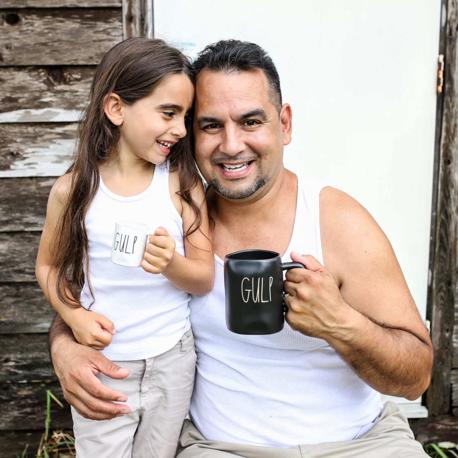 Dad and daughter holding matching Rae Dunn mugs