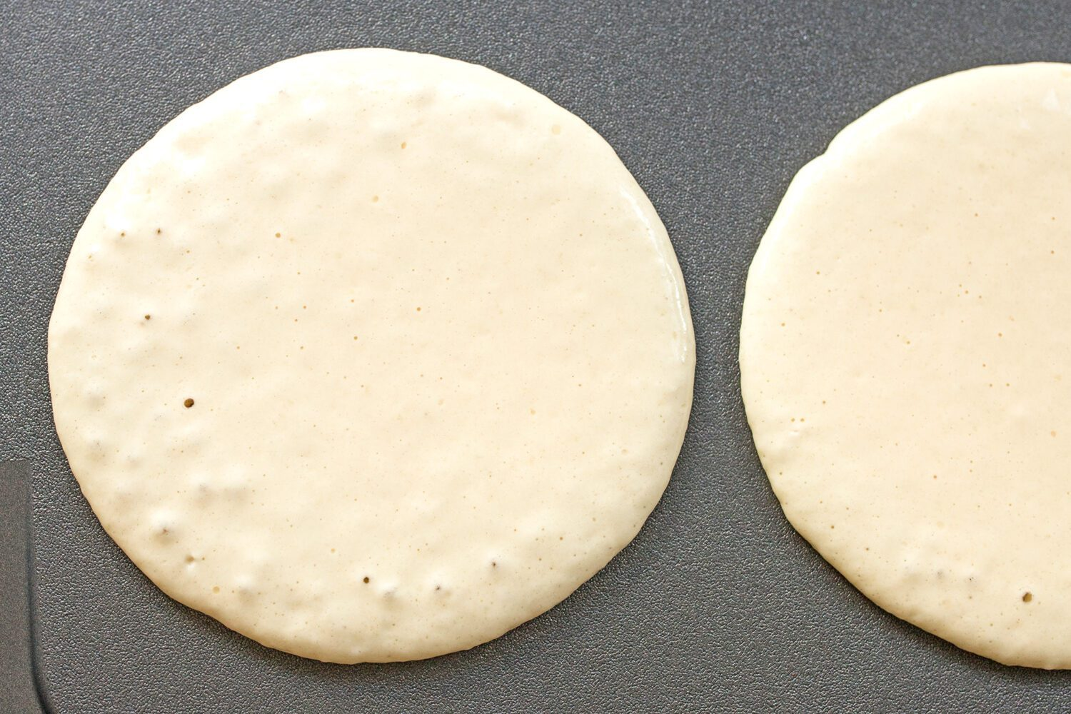 cooking pancakes on a griddle