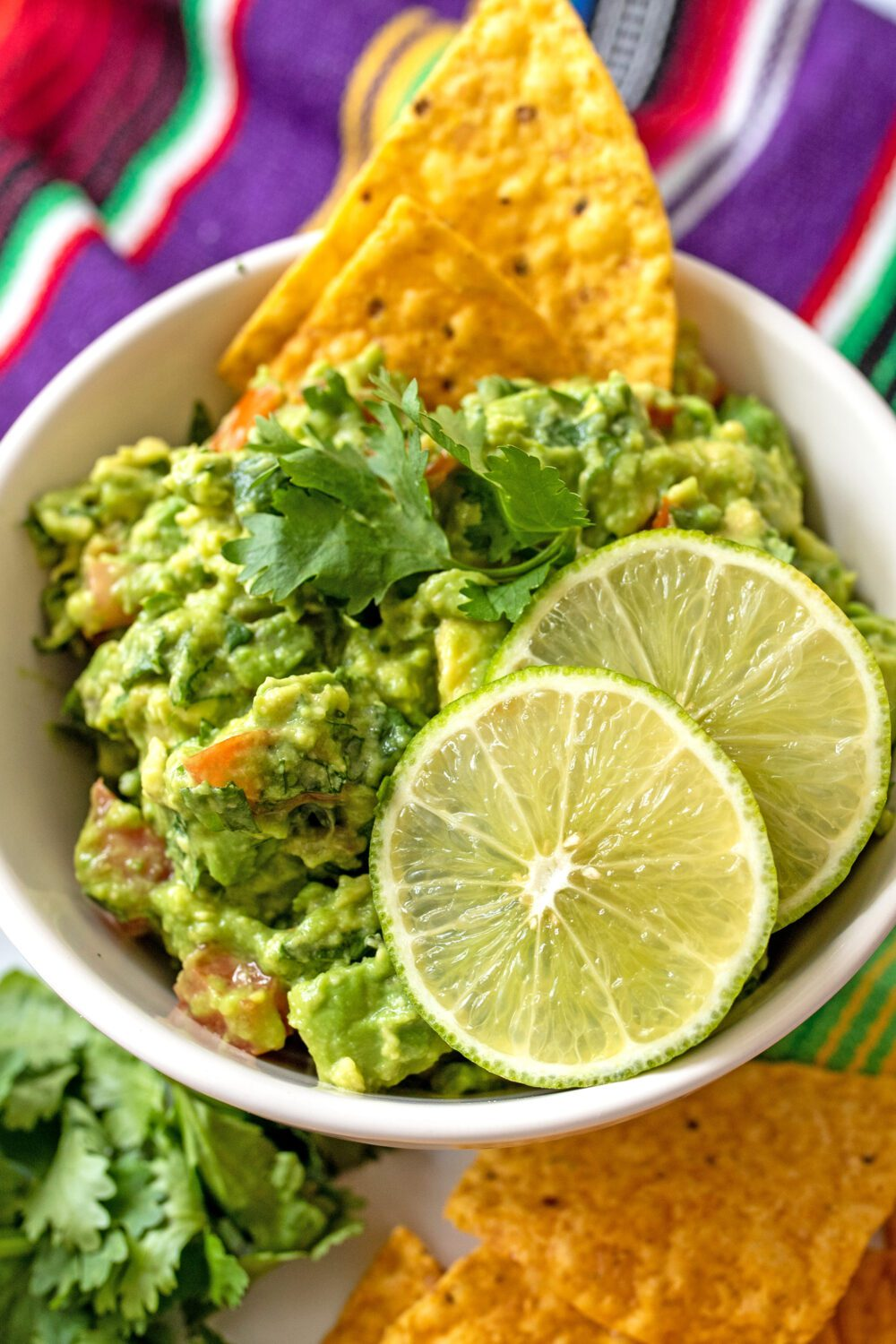 bowl of homemade guacamole with chips