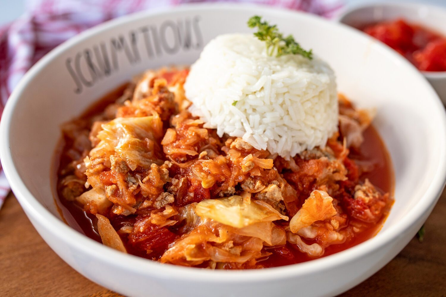 close up of hungarian stuffed cabbage casserole and rice