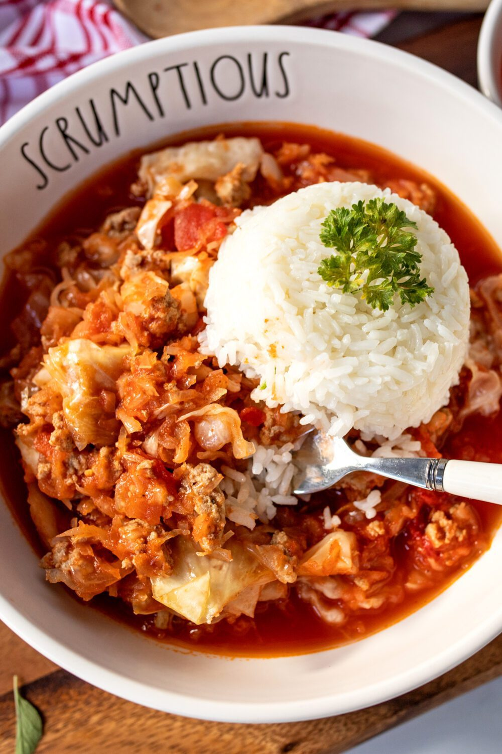 scrumptious rae dunn bowl filled with hungarian stuffed cabbage casserole and rice