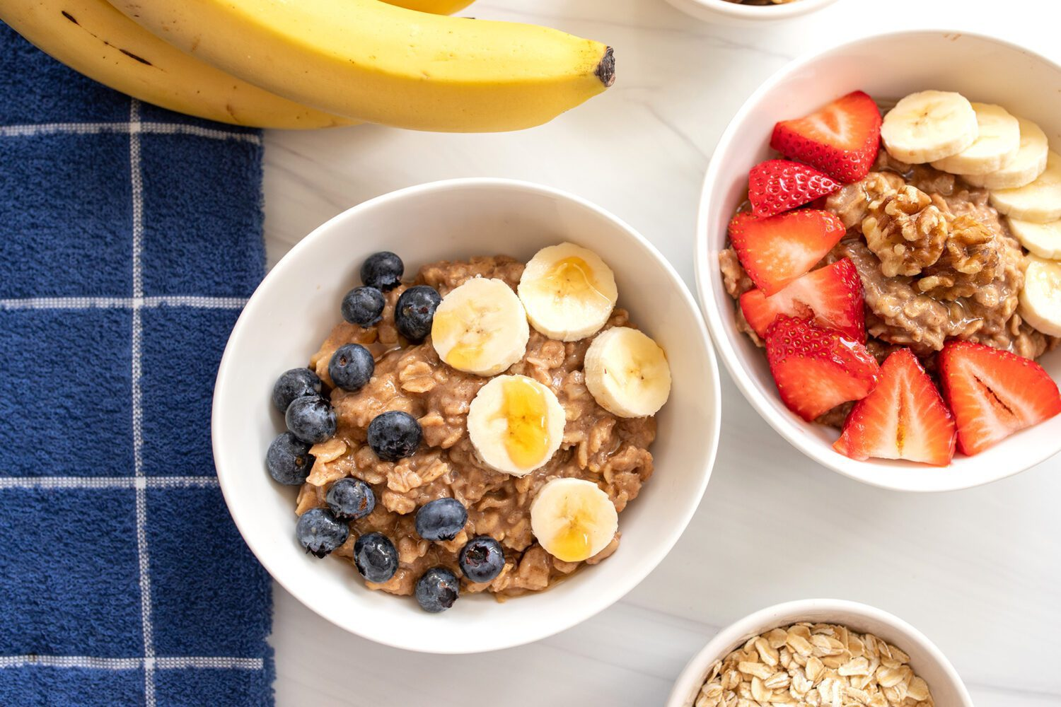 bowls full of oatmeal with fruit