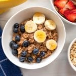 bowl of homemade oatmeal with bananas and blueberries