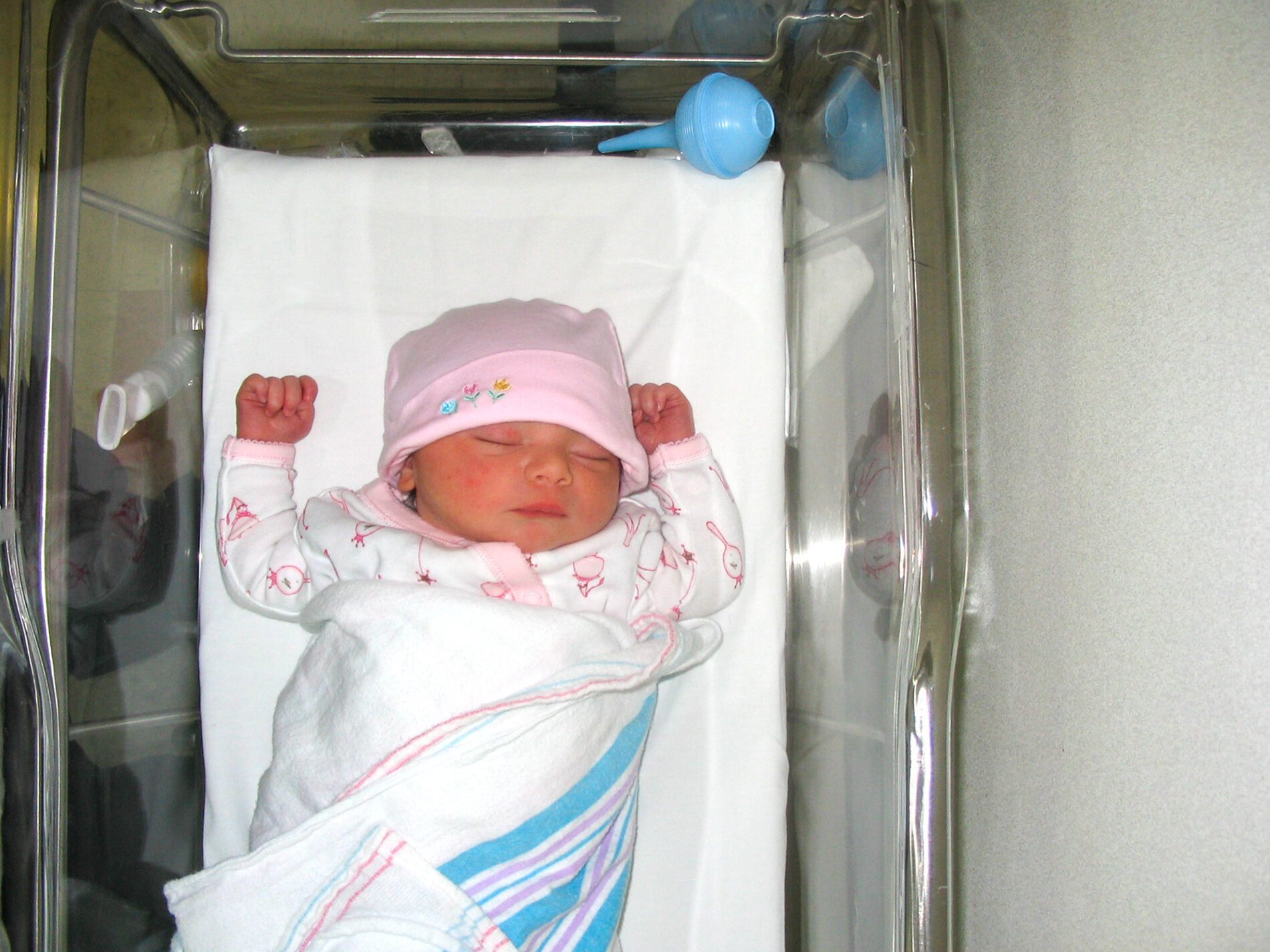 baby girl in the crib at the hospital