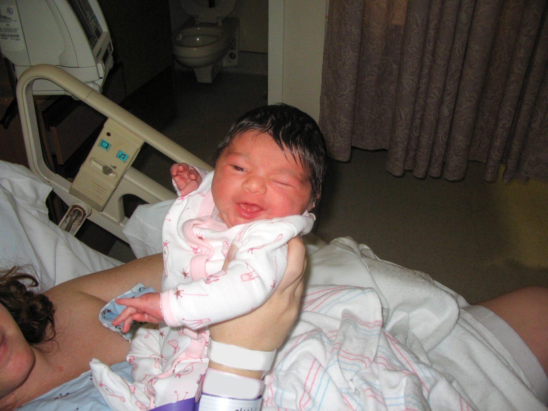 newborn baby girl winking